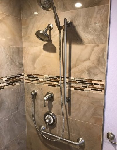 New Handles, Faucet & Showerhead in Remodeled Bathroom